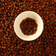 Coffee golden brown texture around white cup — Stock Photo #5503074