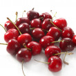 Cherry red wet fruits macro on white — Stock Photo