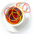 Coffee metaphor with color rubber bands, office - Stock Photo