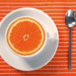 Healthy breakfast cup of orange instead caffeine — Stock Photo