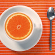 Healthy breakfast cup of orange instead caffeine - Zdjcie stockowe