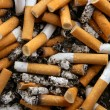 Royalty-Free Stock Photo: Ashtray full of cigarettes. Dirty tobacco texture