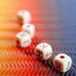Poker dices over colored background — Stock Photo