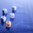 Poker dices over colored background - Stockfoto