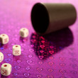 Stock Photo: Poker dices over colored background