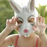 Toddler girl with rabbit white mask — Stock Photo
