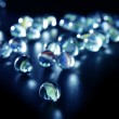 Glass marbles with blue reflections — Stock Photo #5503564