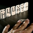 Domino game business metaphor — Stock Photo #5503572