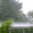 Raining over a white roof in a hurricane storm — Stock Photo