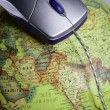 Computer wired mouse over the world  global earth map — Stock Photo