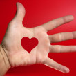Red heart shape drawed on a male human hand — Stock Photo