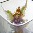 Angel saint figure in the office trash - Foto Stock