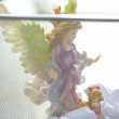 Angel saint figure in the office trash - Stockfoto