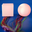 Glowing square and sphere with colorful wires — Stock Photo