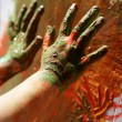 Stock Photo: Children artist hands painting colorful