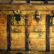Old wooden chest, trunk in golden color - Stock Photo