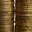 Euro coin columns, golden cash over white background — Stock Photo #5504088