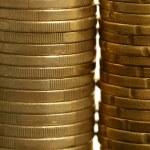 Euro coin columns, golden cash over white background — Stock Photo #5504089