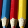 Colorful set three pen in vibrant colors over black - Stock Photo