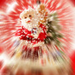 Santa claus figurine on a glass snowing ball — Stock Photo
