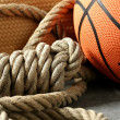 Gym corner, basketball ball and rope — Stock Photo