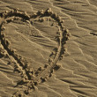 Hearth draw on the beach sand surface — 图库照片