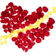 Cupid arrow in a red rose petals heart shape — Stock Photo