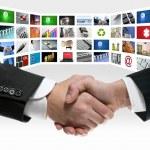 Tech tv video communication screen handshake — Stock Photo