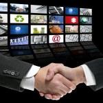 Businessman handshake over perspective screen — Stock Photo