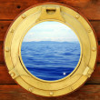 Boat closed porthole with vacation seascape view — Stock Photo