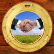 Royalty-Free Stock Photo: Businessmen handshake view from boat round window