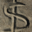 American currency  dollar sign on the beach sand — Stock Photo