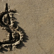 American currency  dollar sign on the beach sand - Stock fotografie