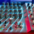 Audio mixer music desk under colorful lights - Stock Photo