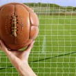 Football ball in hand net soccer goal — Stock Photo