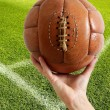 Aged vintage retro football leather ball - Foto Stock