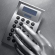 Business futuristic silver hand calculator — Stock Photo #5504475