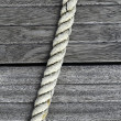 Royalty-Free Stock Photo: Marine rope over gray aged teak wood