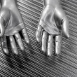 Royalty-Free Stock Photo: Hands open futuristic robot silver steel over gray