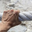 Man hand grab grip strong big aged rope — Stock Photo