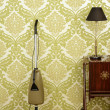 图库照片: Retro vacuum cleaner vintage sixties wallpaper