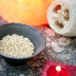 Aromatherapy, red candle, sea marine natural sponge and bowl of rice — Stock Photo