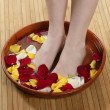 Aromatherapy, flowers feet bath, rose petal — Stock Photo #5504730