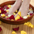 Aromatherapy, flowers feet bath, rose petal — Stock Photo #5504731