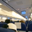 Stock Photo: Airplane with passengers interior view