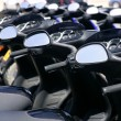 Scooter motorbikes in a row with perspective — Stock Photo