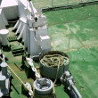 Постер, плакат: Industrial green deck boat old big winch