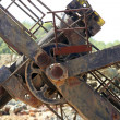 Excavator bulldozer arm wheel rusted detail — Stock fotografie