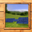 Wood window solar plates meadow view - Stock Photo