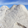 Salt mountain blue sky prevention roads ice - Stock Photo